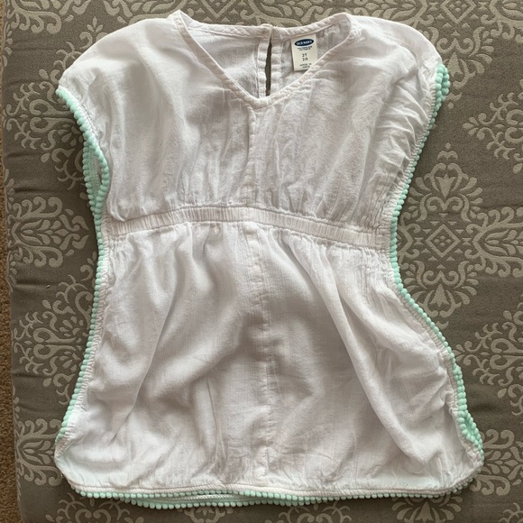 708839b21652d Baby Girl White Swimsuit Coverup w/ Pom Pom detail. Old Navy.  M_5c3b6d2a4ab633fe936d981c. M_5c3b6d2cde6f62dca8953d60